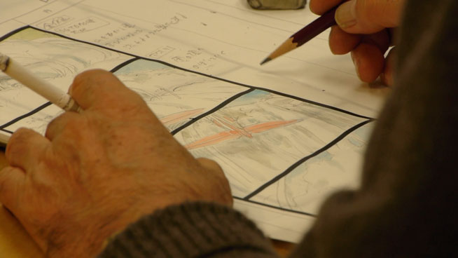 Miyazaki drawing a storyboard for a scene with a plane